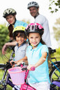 Family on cycle ride in countryside smiling to camera Stock Images