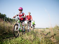 Family cycling outdoors a in summer Royalty Free Stock Photos