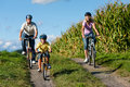 Family is cycling in summer Royalty Free Stock Photo