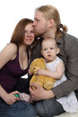 Family: dad holds baby and kisses mother Stock Photo