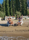 Family on deck chairs at sand beach 2 Stock Image