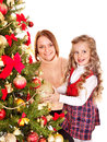 Family decorate christmas tree mother with daughter isolated Royalty Free Stock Photos