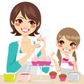 Family decorating cupcakes mother and daughter delicious with strawberry cream isolated on white background Royalty Free Stock Image