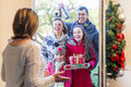 Family delivering presents at Christmas Royalty Free Stock Photo