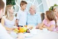 Family dinner portrait of senior and young couples with their children having at home Stock Image