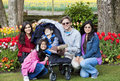Family with disabled boy in the tulips gardens Royalty Free Stock Images