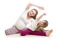 Family doing gymnastics. Pregnant woman with daughter exercising stretching on floor Royalty Free Stock Photo