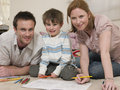 Family drawing together on floor portrait of happy Stock Photography
