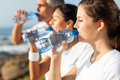 Family drinking water active after jogging in the morning Royalty Free Stock Photography