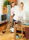 Family dusting and hoovering Royalty Free Stock Photo