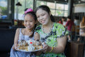 Family eat honey toast mother and daughter in restaurant Royalty Free Stock Image