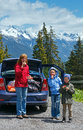 Family eat strawberry in alps mountain near car Stock Photo