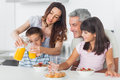 Family eating breakfast in kitchen together Royalty Free Stock Photo
