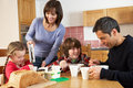 Family Eating Breakfast Together In Kitchen Stock Photography