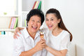 Family eating ice cream sharing an happy asian sharing food at home beautiful senior mother and adult daughter dessert together Stock Photo