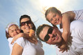 Family eating ici cream in front of ocean a the child is on piggyback with smile Stock Photography