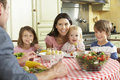 Family Eating Meal Together In Kitchen Royalty Free Stock Photo