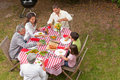 Family eating outside in the garden Royalty Free Stock Photography