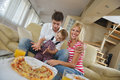 Family eating pizza happy young tasty with cheesa and dring healthy and fresh orange juice Royalty Free Stock Image