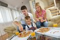 Family eating pizza happy young tasty with cheesa and dring healthy and fresh orange juice Royalty Free Stock Images