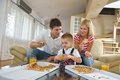 Family eating pizza happy young tasty with cheesa and dring healthy and fresh orange juice Stock Images