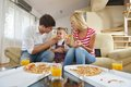 Family eating pizza happy young tasty with cheesa and dring healthy and fresh orange juice Stock Image