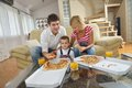 Family eating pizza happy young tasty with cheesa and dring healthy and fresh orange juice Royalty Free Stock Photos