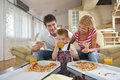 Family eating pizza happy young tasty with cheesa and dring healthy and fresh orange juice Stock Photography
