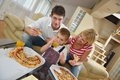Family eating pizza happy young tasty with cheesa and dring healthy and fresh orange juice Royalty Free Stock Photo