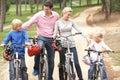 Family enjoying bike ride in park Royalty Free Stock Photo