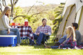 Family enjoying camping holiday in countryside smiling Royalty Free Stock Photography