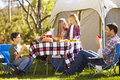 Family enjoying camping holiday in countryside smiling Royalty Free Stock Photos