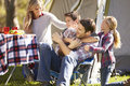 Family enjoying camping holiday in countryside smiling Stock Image