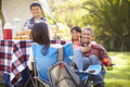 Family enjoying camping holiday in countryside smiling Royalty Free Stock Images