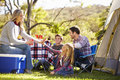 Family enjoying camping holiday in countryside smilng Stock Image