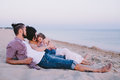 Family enjoying life on the beach Royalty Free Stock Photo