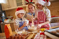 Family enjoying making Christmas cookies