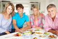 Family enjoying meal at home Stock Photos