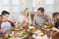 Family Enjoying meal, mealtime Together Royalty Free Stock Photo