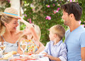 Family Enjoying Meal outdoors Royalty Free Stock Photo