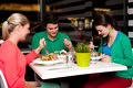 Family enjoying meal outdoors of three at restaurant Royalty Free Stock Photography