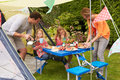 Family Enjoying Meal Outside Tent On Camping Holiday Royalty Free Stock Photo