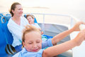 Family enjoying ride on ferry of mother and kids a public at sunset Stock Photos