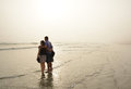 Family enjoying time together on beautiful foggy beach. Royalty Free Stock Photo