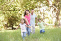 Family Enjoying Walk In Park Royalty Free Stock Photos