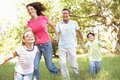 Family Enjoying Walk In Park Stock Images