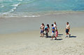 Family enjoying a walk at Thalia Beach, Laguna Beach, California. Royalty Free Stock Photo