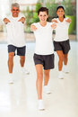 Family exercise indoors happy of three at home Royalty Free Stock Images