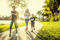 Family exercising and jogging together at the park Royalty Free Stock Photo