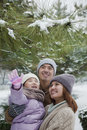 Family exploring in park in winter Royalty Free Stock Photos